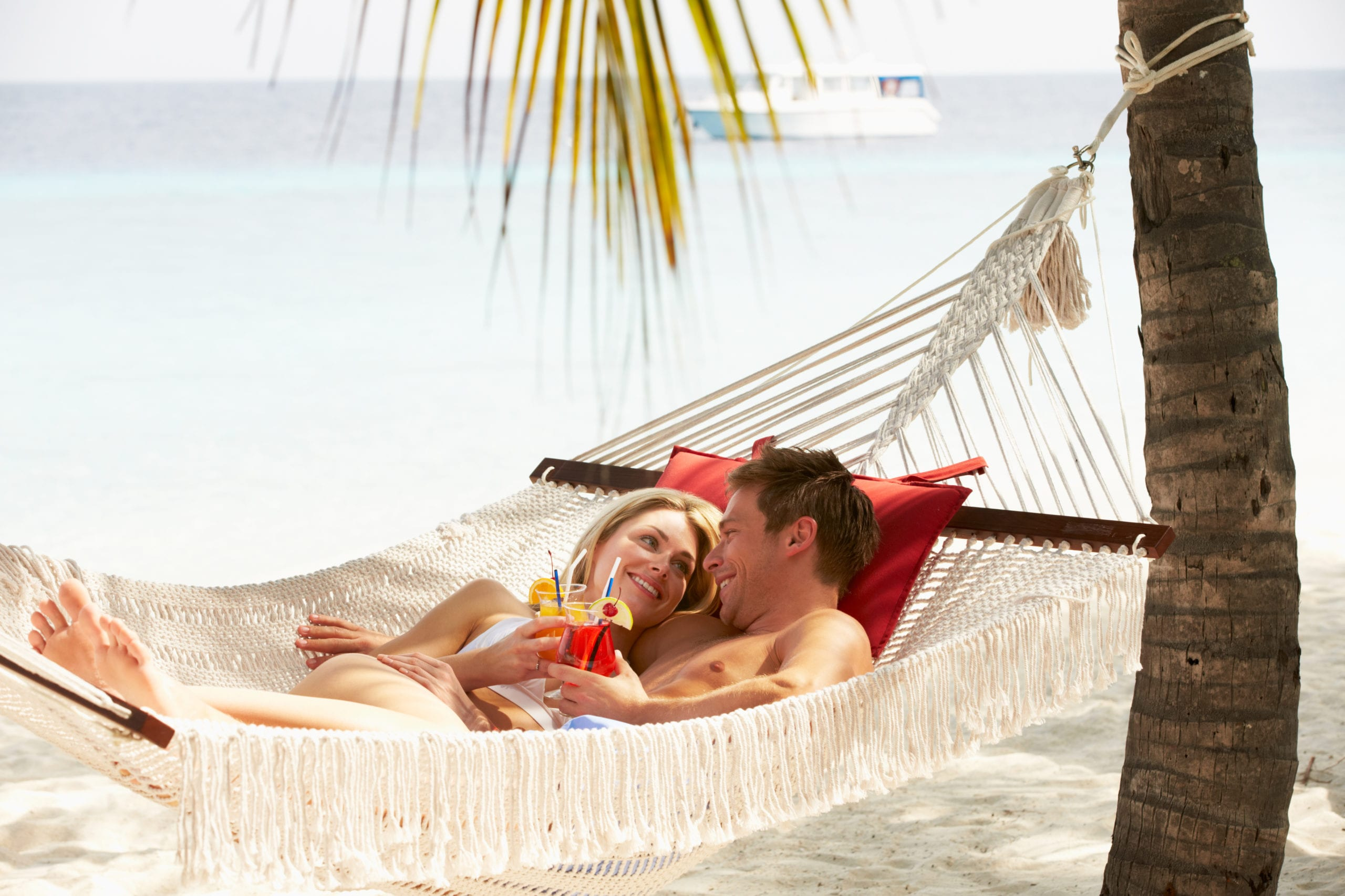 Couple on a Honeymoon in a hammock.