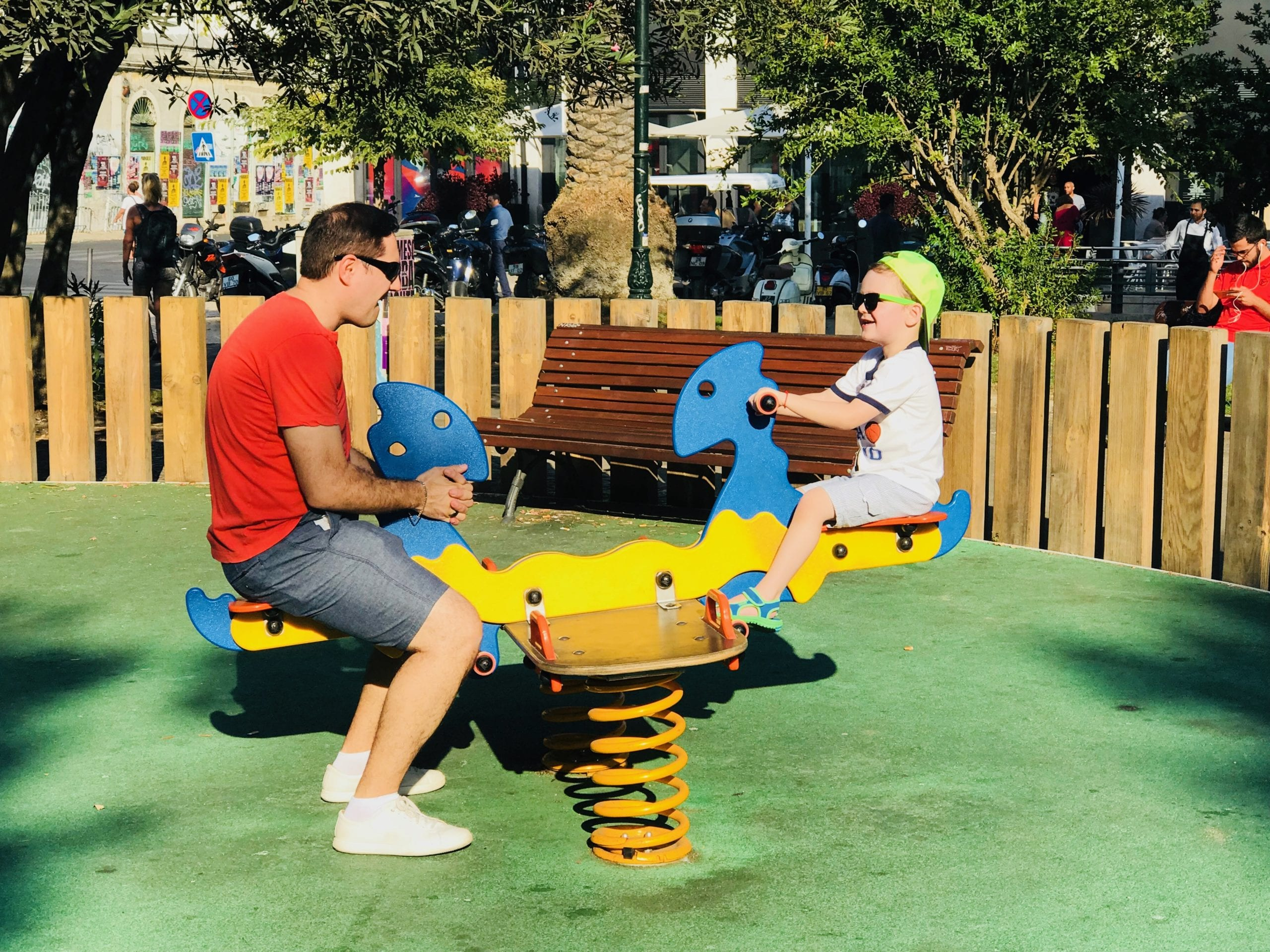 Father and son enjoying a lazy afternoon at a playground in Lisbon, Portugal