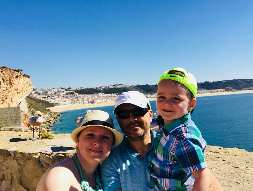 Family picture of travel agent, husband, and son exploring Nazare, Portugal