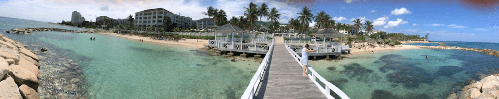 Dock across the shallow water outside of Hyatt Ziva and Zilara resort