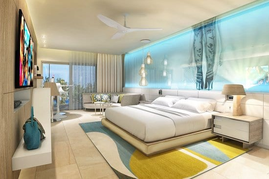 An inside look into a room with a King sized bed at the Breathless Montego Bay Resort.